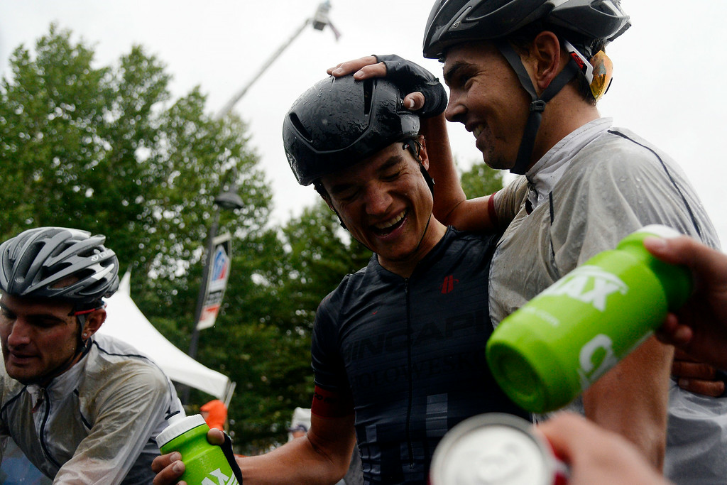 . Robin Carpenter of Hincape Sportsear Development Team is congratulated by teammate Dion Smith after winning stage 2. The USA Pro Challenge stage 2 on Tuesday, August 19, 2014. (Photo by AAron Ontiveroz/The Denver Post)