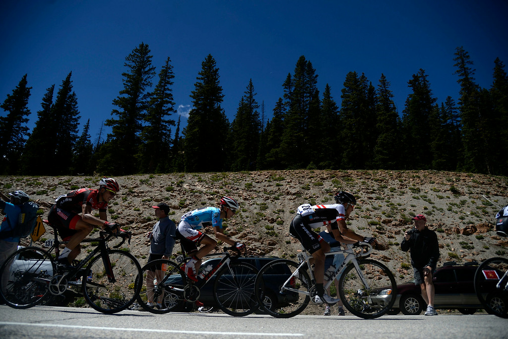 . Riders start their descent after a long climb up Monarch Pass. The USA Pro Challenge stage 3 on Wednesday, August 20, 2014. (Photo by AAron Ontiveroz/The Denver Post)