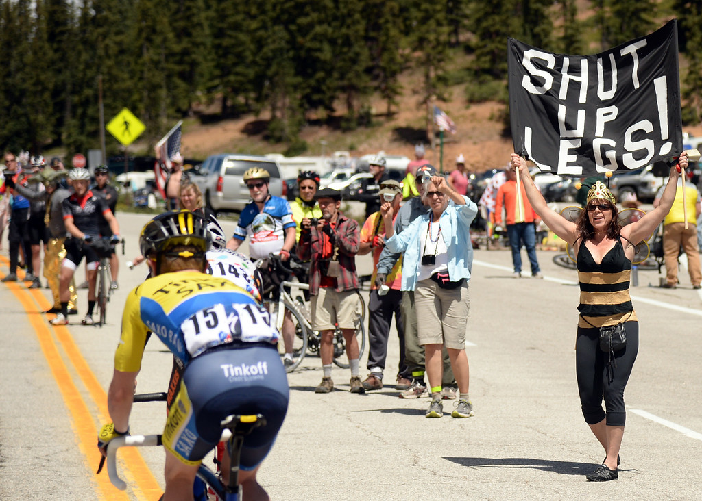 . Fans cheer cyclists of USA Pro Challenge at the summit of Monarch Pass. August 20, 2014. Stage 3 started in Gunnison and headed east for 35 miles before tackling the 11,300 ft. Monarch Pass. The riders descend the eastern slope of the pass and did two 9-mile loops through Salida and the surrounding countryside. (Photo by Hyoung Chang/The Denver Post)