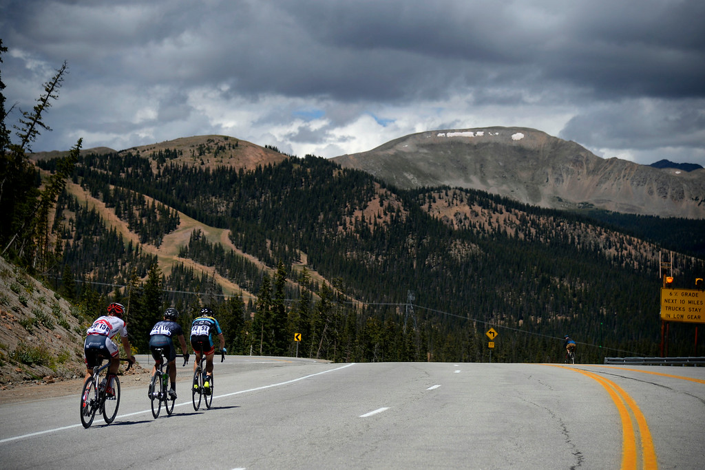 . From left to right: Ruben Zepuntke, Chris Butler and Rob Britton start their descent down Monarch Pass. The USA Pro Challenge stage 3 on Wednesday, August 20, 2014. (Photo by AAron Ontiveroz/The Denver Post)