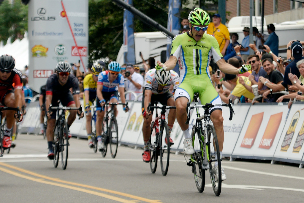 . COLORADO SPRINGS, CO - AUGUST 21: Team Cannondale rider Elia Viviani crosses the line first in downtown Colorado Springs to capture a win during stage 4. The USA Pro Challenge stage 4 on Thursday, August 21, 2014. (Photo by AAron Ontiveroz/The Denver Post)
