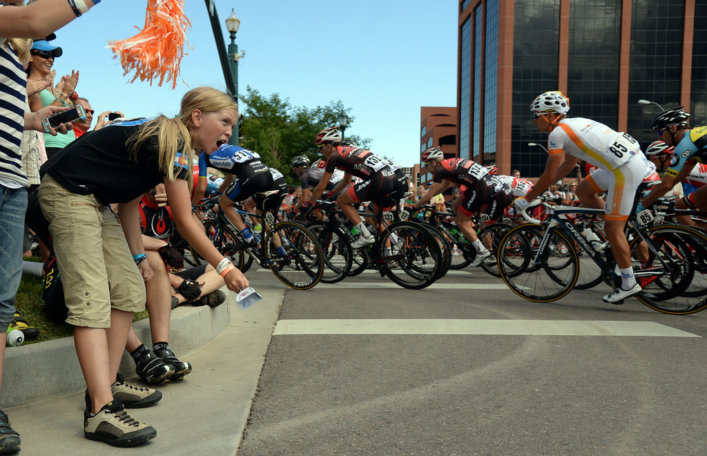 . COLORADO SPRINGS, CO - AUGUST 21: Anna Utesh, 11, of Aurora, cheer USA Pro Challenge peloton in Downtown Colorado Springs during the Stage 4 on Thursday, August 21, 2014. After a ceremonial start at the  Broadmoor, the race head into town and join up with a 16-mile circuit that raced four times. With climbs through Garden of the Gods, Mesa Rd. and the infamous Ridge Rd. (Photo by Hyoung Chang/The Denver Post)