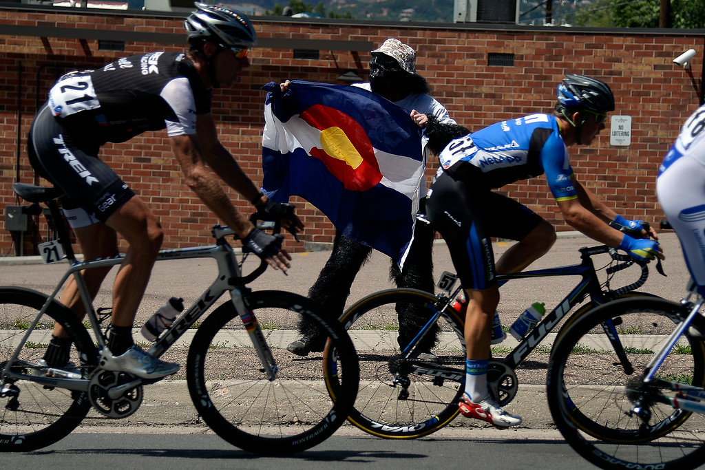 . COLORADO SPRINGS, CO - AUGUST 21: T.J. Teisher supports riders during stage 4. The USA Pro Challenge stage 4 on Thursday, August 21, 2014. (Photo by AAron Ontiveroz/The Denver Post)