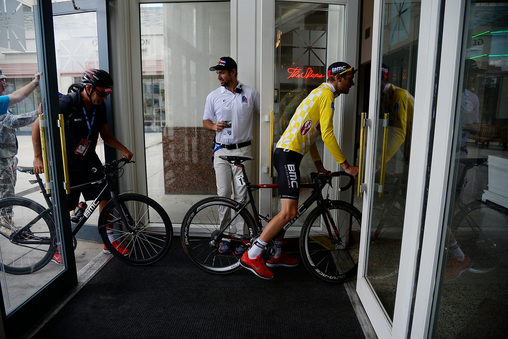 . COLORADO SPRINGS, CO - AUGUST 21: Tejay van Garderen arrives in the Hilton Hotel lobby by way of bicycle after retaining the yellow jersey in stage 4. The USA Pro Challenge stage 4 on Thursday, August 21, 2014. (Photo by AAron Ontiveroz/The Denver Post)