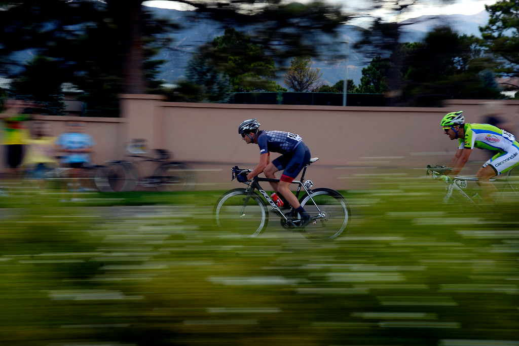 . COLORADO SPRINGS, CO - AUGUST 21: Oscar Clark (lead) and Alan Marangoni make their way through the city during stage 4. The USA Pro Challenge stage 4 on Thursday, August 21, 2014. (Photo by AAron Ontiveroz/The Denver Post)