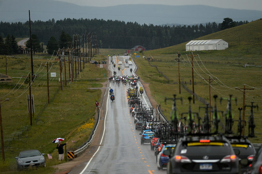 . BRECKENRIDGE, CO - AUGUST 22: The convoy of riders, officials and team support make their way through stage 5. The USA Pro Challenge stage 5 on Friday, August 22, 2014. (Photo by AAron Ontiveroz/The Denver Post)