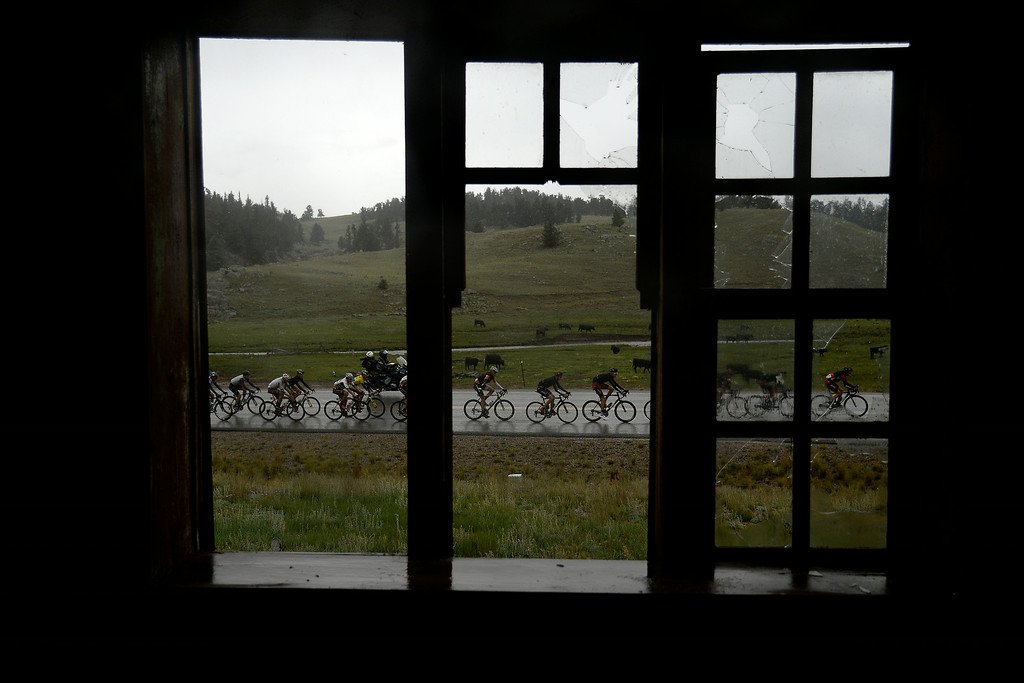. BRECKENRIDGE, CO - AUGUST 22: Cyclists make their way in front of an abandoned ranch house during stage 5. The USA Pro Challenge stage 5 on Friday, August 22, 2014. (Photo by AAron Ontiveroz/The Denver Post)
