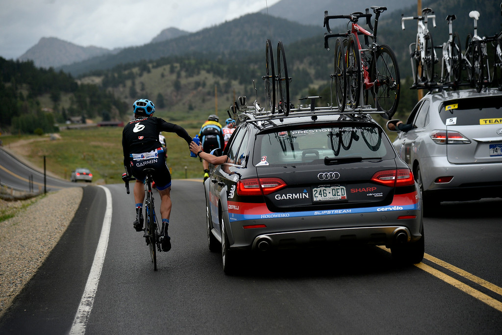 . BRECKENRIDGE, CO - AUGUST 22: A Garmin-Sharp rider gets a bottle of water during stage 5. The USA Pro Challenge stage 5 on Friday, August 22, 2014. (Photo by AAron Ontiveroz/The Denver Post)