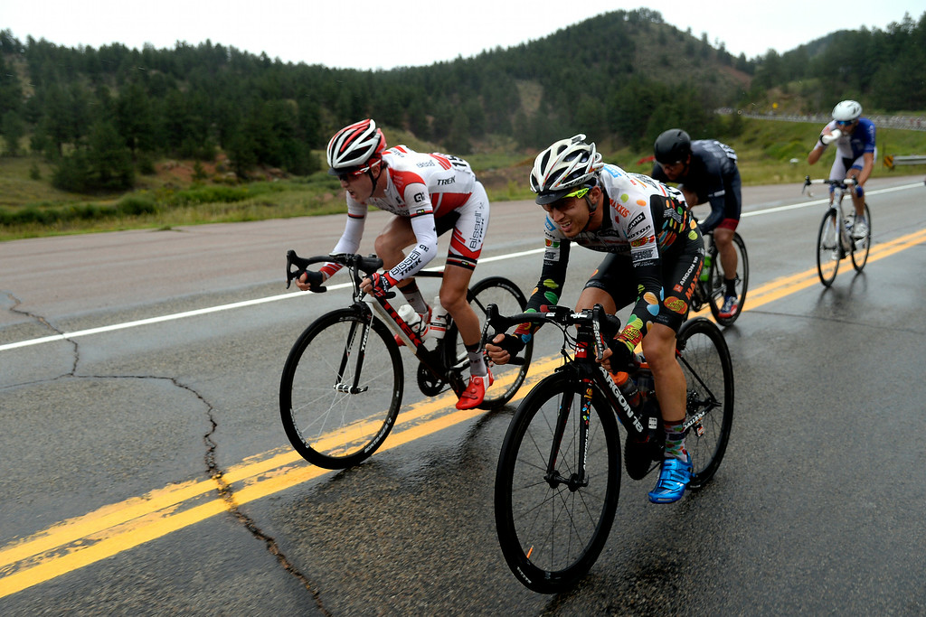 . BRECKENRIDGE, CO - AUGUST 22: Gregory Daniel (left) and Steve Fisher (right) pedal through the rain during stage 5. The USA Pro Challenge stage 5 on Friday, August 22, 2014. (Photo by AAron Ontiveroz/The Denver Post)