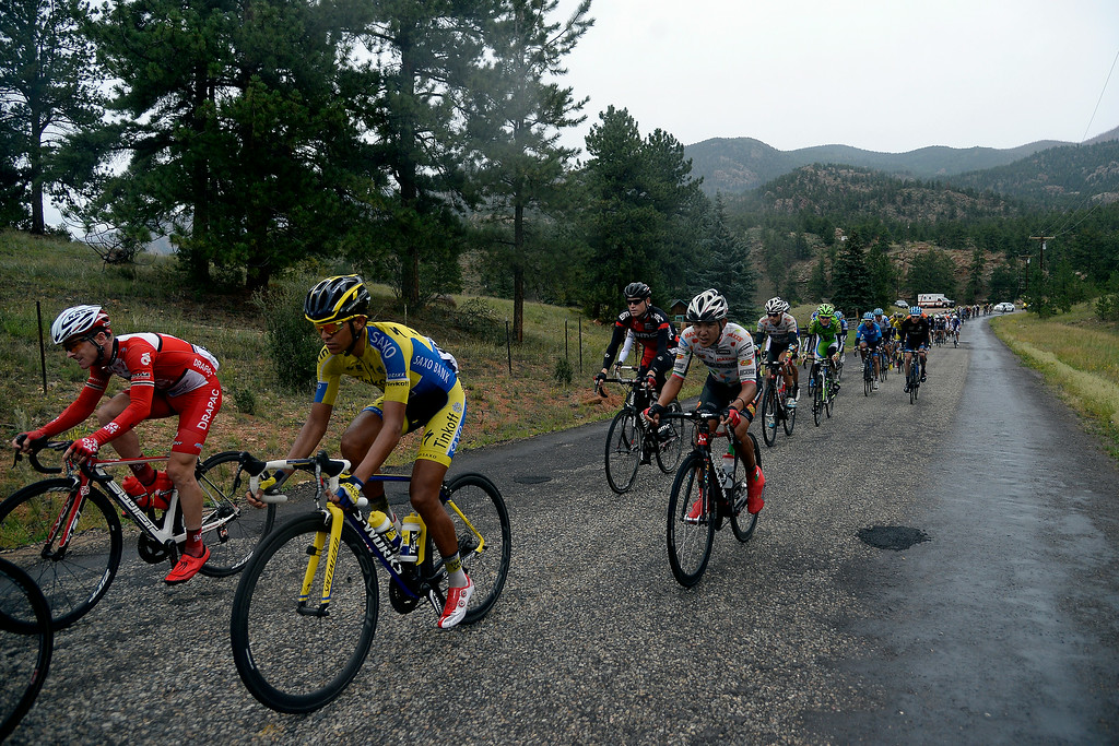 . BRECKENRIDGE, CO - AUGUST 22: Riders battle the elements during their stage 5 ride. The USA Pro Challenge stage 5 on Friday, August 22, 2014. (Photo by AAron Ontiveroz/The Denver Post)