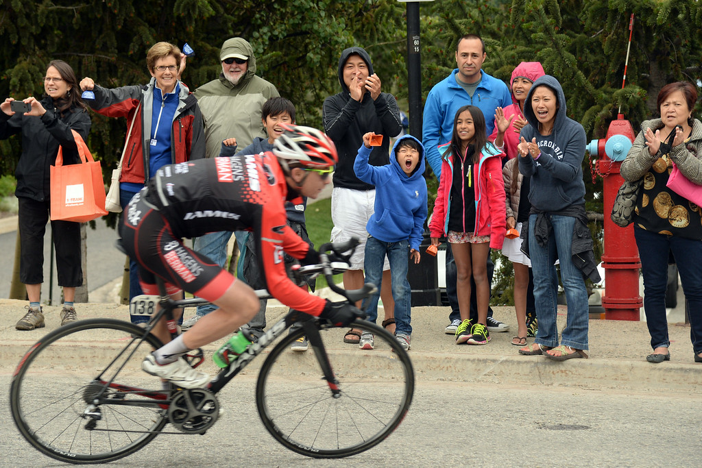 . BRECKENRIDGE, CO - AUGUST 22: Fans cheer the Rob Sauire of Jamis-Hagens Berman (138) at downtown Breckenridge during The USA Pro Challenge stage 5 on Frdiay, August 22, 2014. (Photo by Hyoung Chang/The Denver Post)