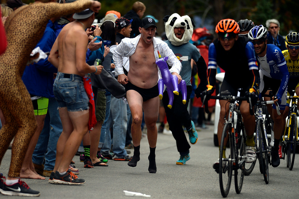. BRECKENRIDGE, CO - AUGUST 22: A man in underpants, a semi-formal shirt and dress socks supports riders as they make their way to the home stretch during stage 5. The USA Pro Challenge stage 5 on Friday, August 22, 2014. (Photo by AAron Ontiveroz/The Denver Post)