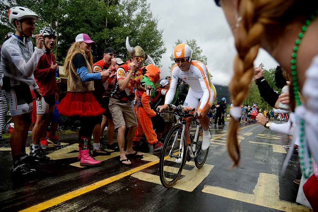 . VAIL, CO - AUGUST 23: Fans cheer on Aaron Perry of Novo Nordisk during stage 6. The USA Pro Challenge stage 6 time trial on Saturday, August 23, 2014. (Photo by AAron Ontiveroz/The Denver Post)