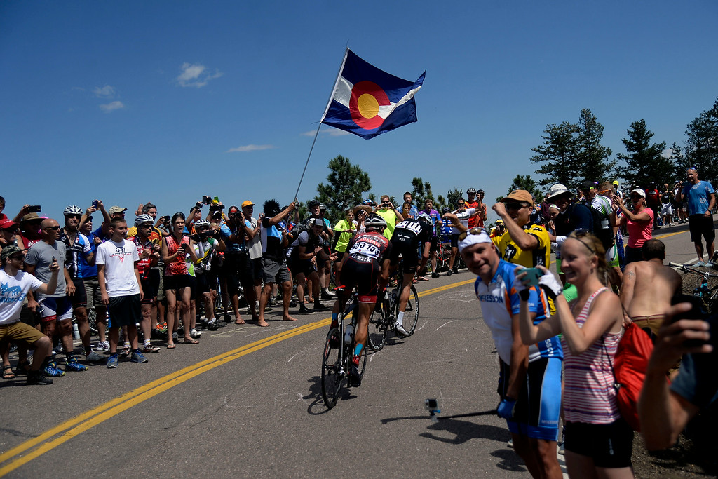 . Matt Cooke makes a climb up Lookout Mountain as fans cheer him on during stage 7. The USA Pro Challenge stage 7 on Sunday, August 24, 2014. (Photo by AAron Ontiveroz/The Denver Post)