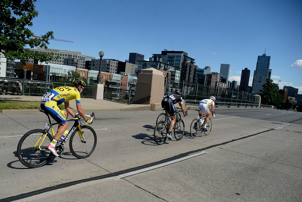 . The lead pack -- led by Javier Megias Leal, Jens Voigt and Michael Rogers --  makes their way towards downtown Denver during stage 7 The USA Pro Challenge stage 7 on Sunday, August 24, 2014. (Photo by AAron Ontiveroz/The Denver Post)