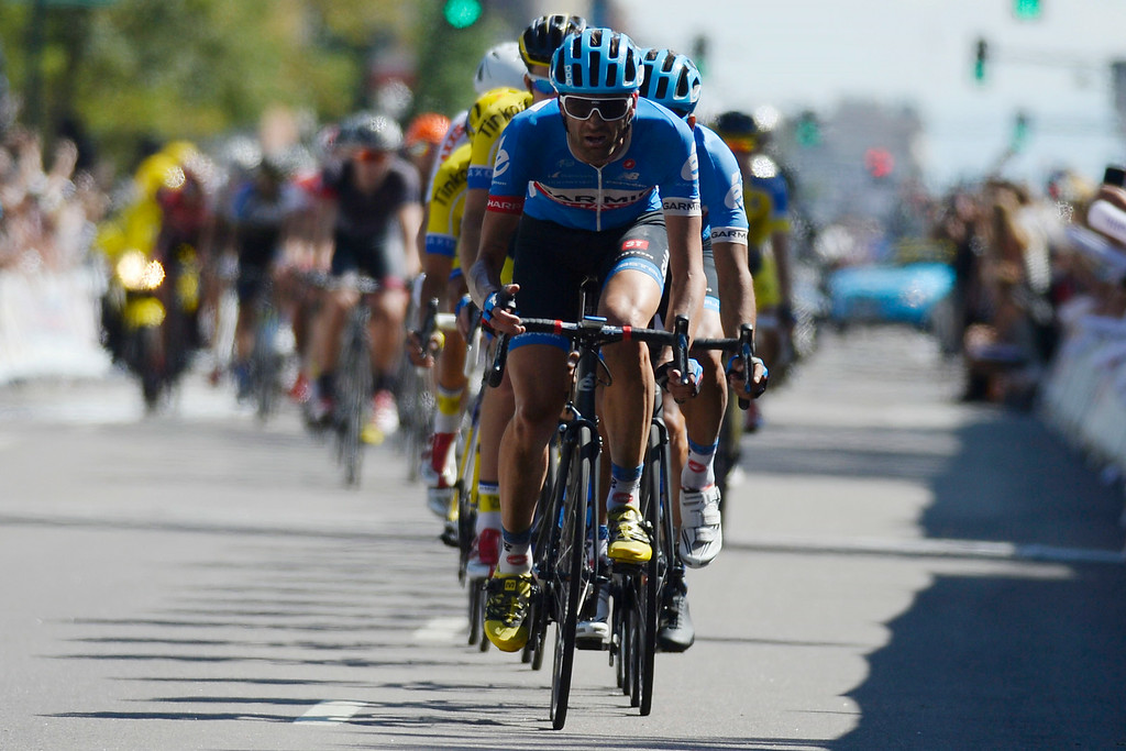 . Janier Acevedo leads the pack entering the final lap of stage 7. The USA Pro Challenge stage 7 on Sunday, August 24, 2014. (Photo by AAron Ontiveroz/The Denver Post)