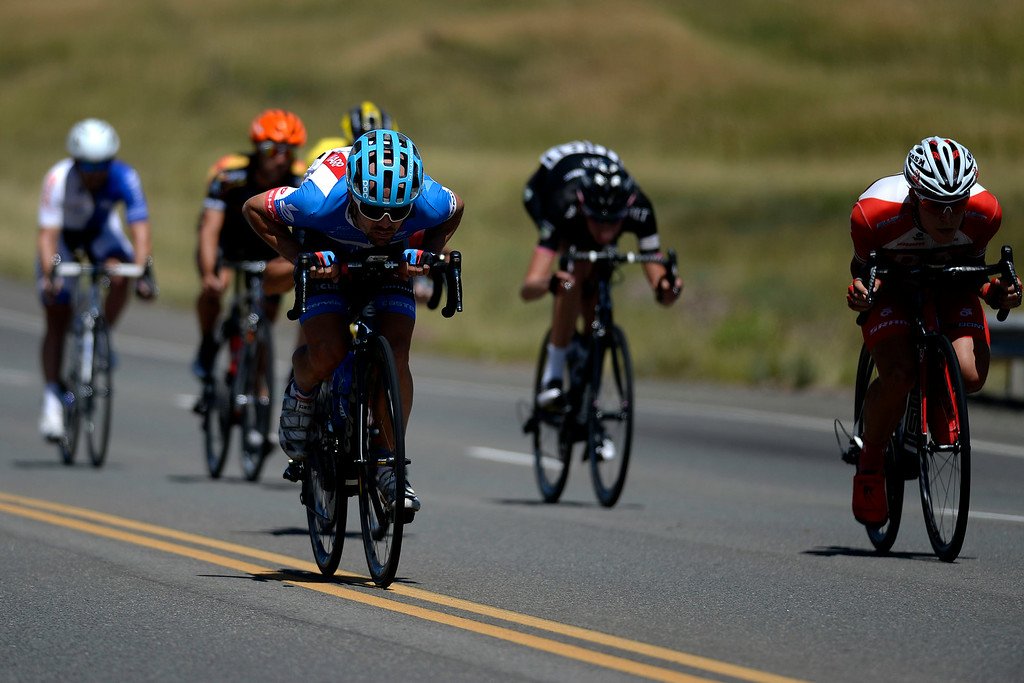 . Caleb Fairly tucks with other riders as they approach Golden. The USA Pro Challenge stage 7 on Sunday, August 24, 2014. (Photo by AAron Ontiveroz/The Denver Post)