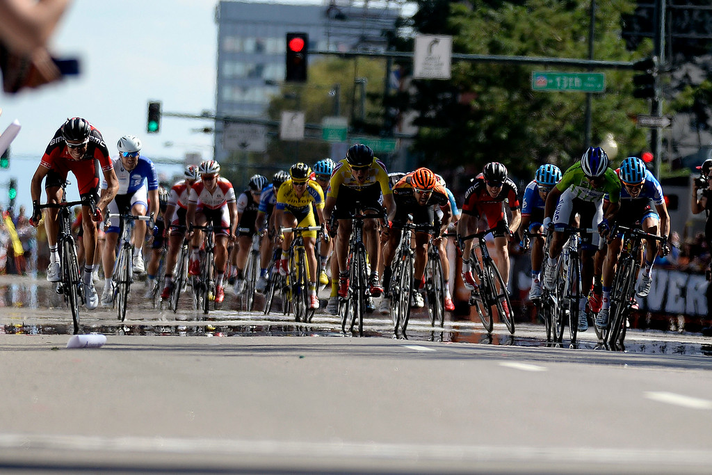 . A large pack races towards the finish line during stage 7. The USA Pro Challenge stage 7 on Sunday, August 24, 2014. (Photo by AAron Ontiveroz/The Denver Post)