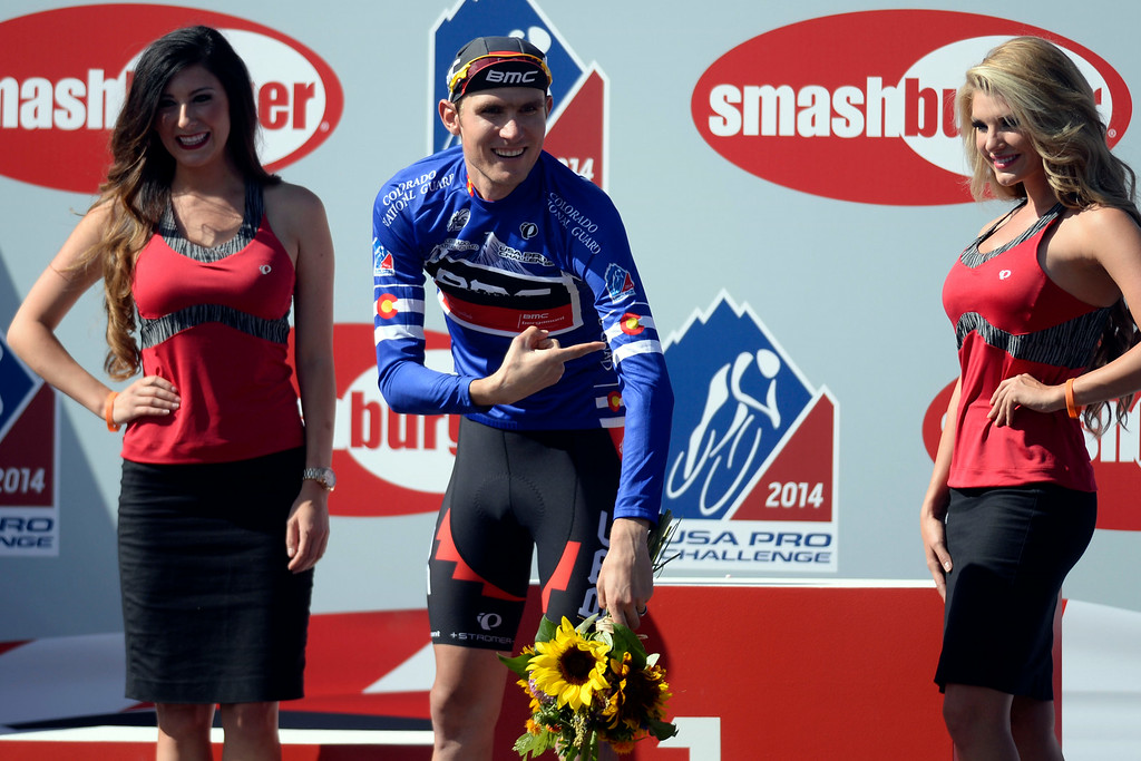 . Colorado native and overall winner Tejay van Garderen points to the Colorado state flag on his best Colorado rider jersey upon completion of stage 7. The USA Pro Challenge stage 6 time trial on Saturday, August 23, 2014. (Photo by AAron Ontiveroz/The Denver Post)