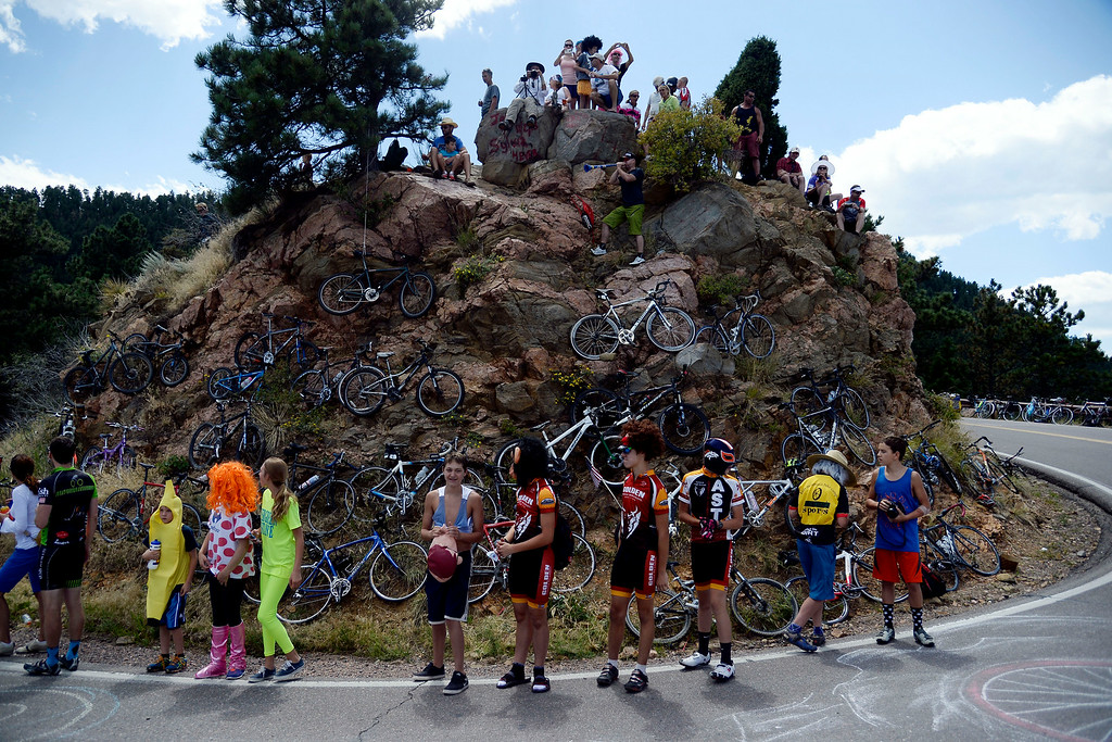 . Fans gather on Lookout Mountain with their bikes as they await the riders\' pass. The USA Pro Challenge stage 7 on Sunday, August 24, 2014. (Photo by AAron Ontiveroz/The Denver Post)