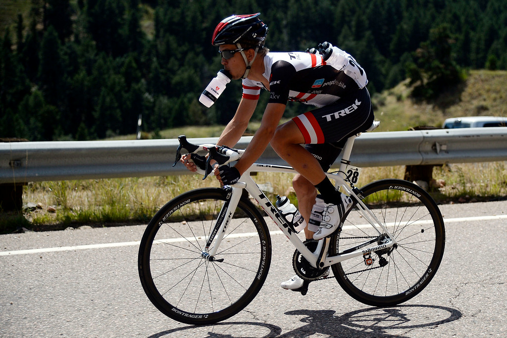 . Riccardo Zoidl gets a drink of water as he descends Lookout Mountain. The USA Pro Challenge stage 7 on Sunday, August 24, 2014. (Photo by AAron Ontiveroz/The Denver Post)