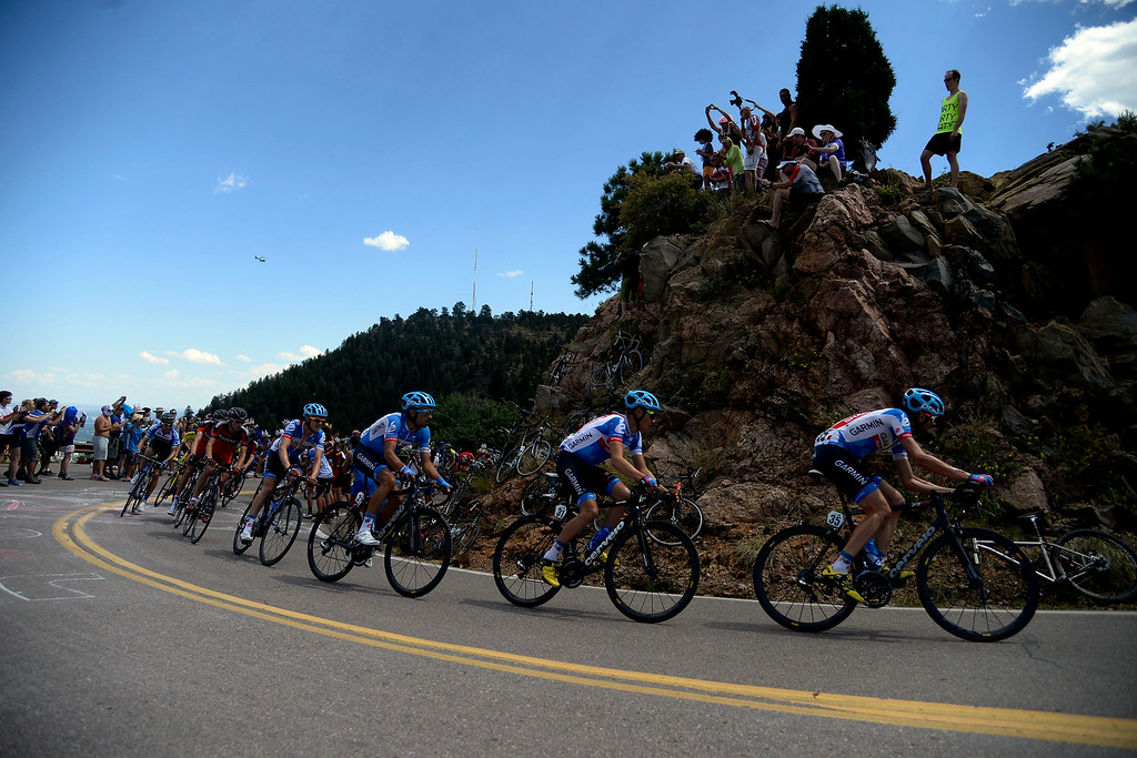 . Riders pass fans on Lookout Mountain during stage 7. The USA Pro Challenge stage 7 on Sunday, August 24, 2014. (Photo by AAron Ontiveroz/The Denver Post)