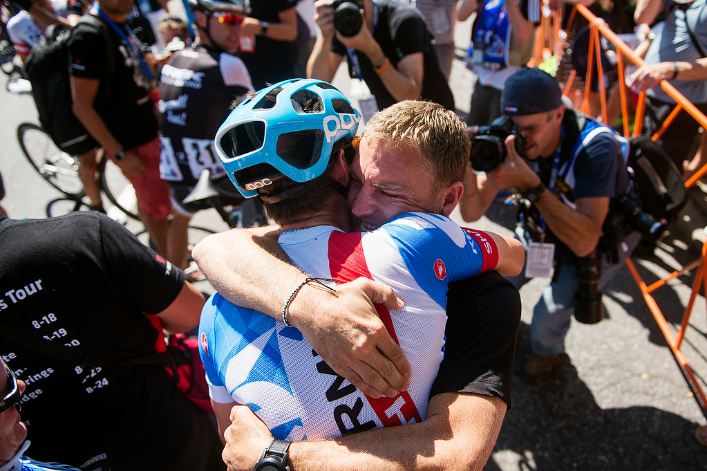 . Robbie Hunter, sports director for Team Garmin-Sharp, hugs cyclist Alex Howes after he won Stage 7 of the USA Pro Challenge from Boulder to Denver on August 24, 2014, in Denver, Colorado. (Photo by Daniel Petty/The Denver Post)