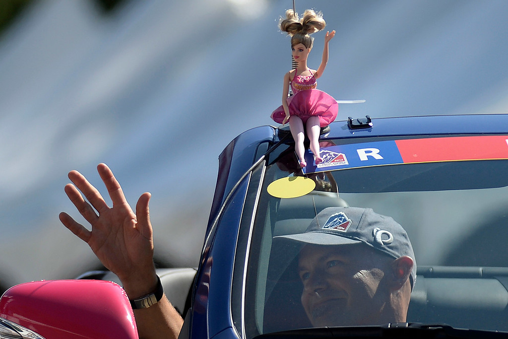 . Barbie and a race official wave to the crowd during stage 7. The USA Pro Challenge stage 6 time trial on Saturday, August 23, 2014. (Photo by AAron Ontiveroz/The Denver Post)