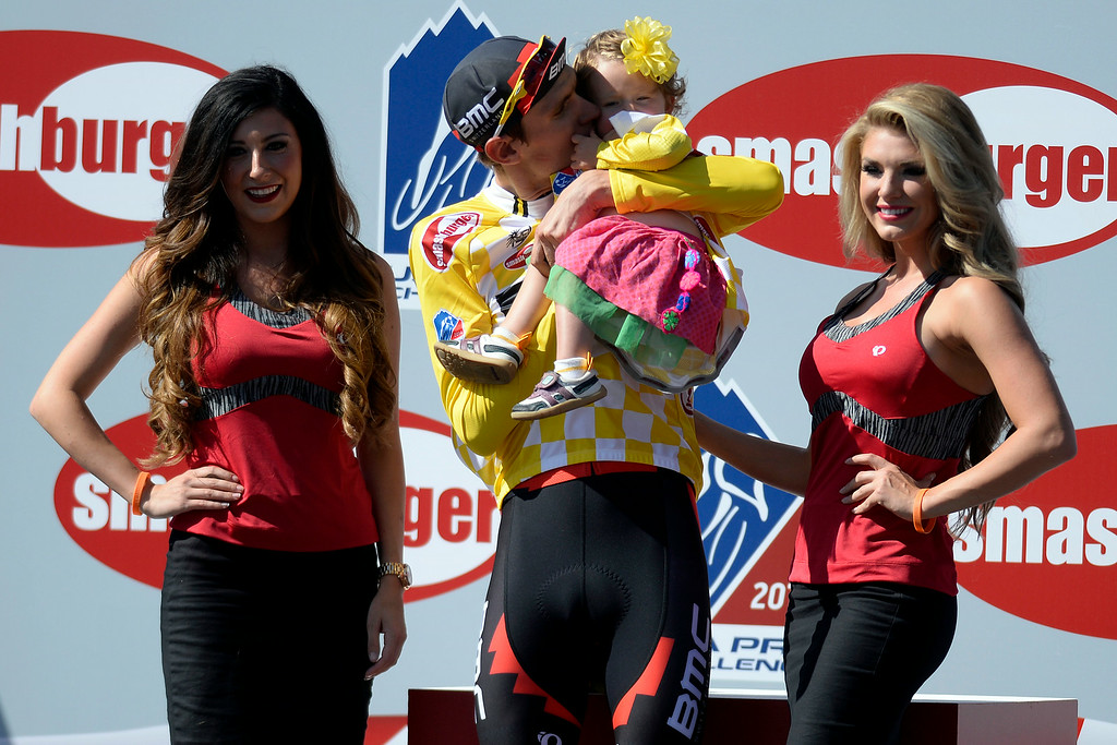 . Tejay van Garderen kisses his daughter, Rylan, after capturing an overall win upon completion of stage 7. The USA Pro Challenge stage 6 time trial on Saturday, August 23, 2014. (Photo by AAron Ontiveroz/The Denver Post)