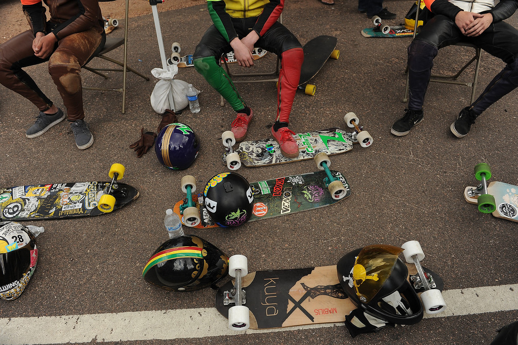 . Riders take a break surrounded by boards in between heats at the starting line of the taking part in the International Pikes Peak Downhill Longboarding Competition.  Photo by Helen H. Richardson/The Denver Post