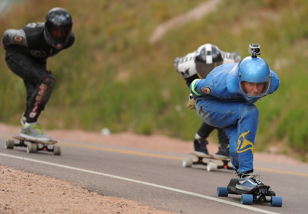 . Frederick Lundstrom, of Sweden, focuses on the road ahead as he races down the 1.4-mile course on Pikes Peak outside of Colorado Springs on September 8, 2013 during the International Pikes Peak Downhill Longboarding Competition.   Photo by Helen H. Richardson/The Denver Post