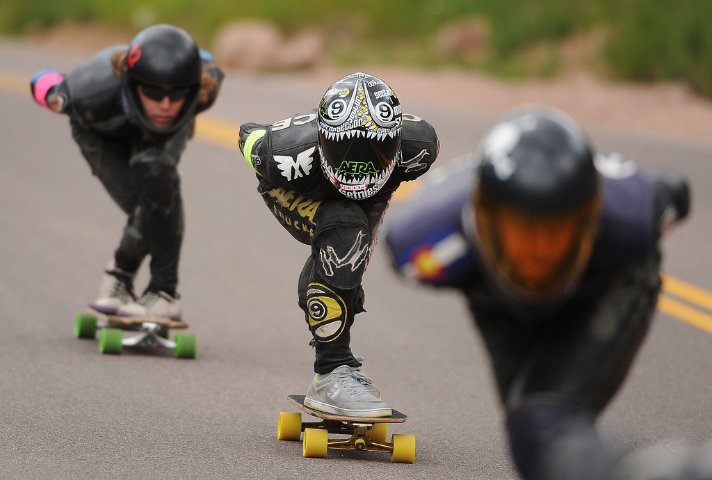 . Junior racer Chance Gaul, center, competes against the open riders as he focuses on the road ahead .  Photo by Helen H. Richardson/The Denver Post