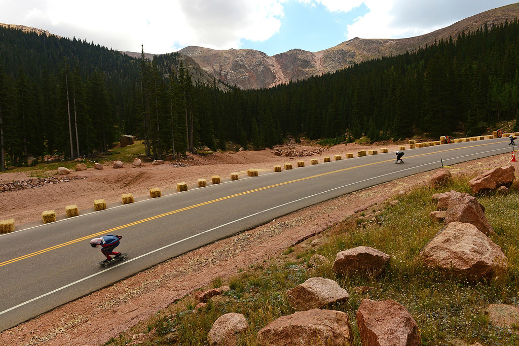 . A rider races down the 1.4-mile course with Pikes Peak as a backdrop during the International Pikes Peak Longboarding Competition on Pikes Peak outside of Colorado Springs, CO on September 8, 2013.    Photo by Helen H. Richardson/The Denver Post