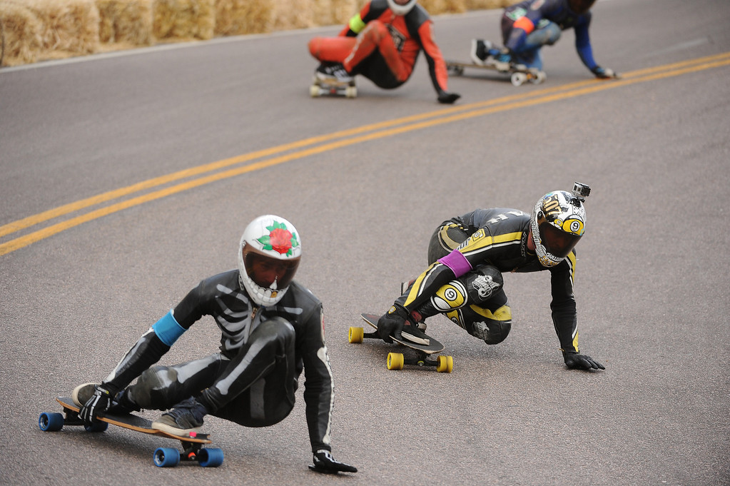 . Racer Micah Green, in yellow and black,  attempts to pace Billy Bones, left, during a heat of the open division as they race down the course.  Photo by Helen H. Richardson/The Denver Post