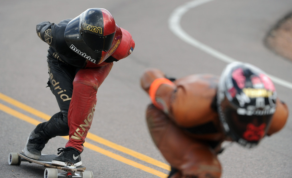 . Winner Zac Maytum, left, gets ready to blast past second-place rider Jimmy Riha, right, as the two round the second to last turn in the race.  Photo by Helen H. Richardson/The Denver Post