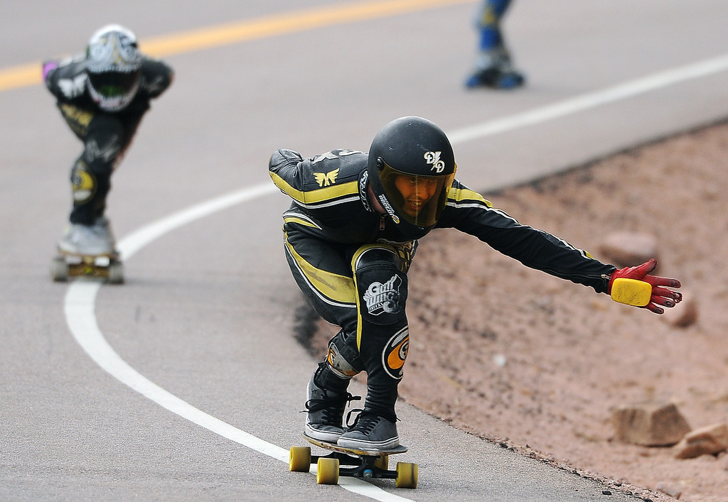 . AJ Haiby extends out his hand as he focuses on the road ahead while racing down the course on Pikes Peak. The 1.4-mile course started at 11,446 feet and ended at 10,767 feet giving the riders a 680 foot drop in elevation and grades of 9.2% to 14.15%.  Riders reached speeds of 55 mph.    Photo by Helen H. Richardson/The Denver Post