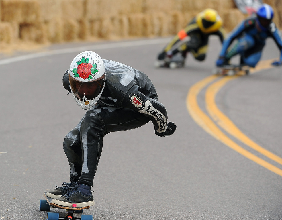 . Billy Bones makes a fast descent as he races down the 1.4-mile course on Pikes Peak outside of Colorado Springs, CO, on September 8, 2013 during the International Pikes Peak Downhill Longboarding Competition.   Photo by Helen H. Richardson/The Denver Post