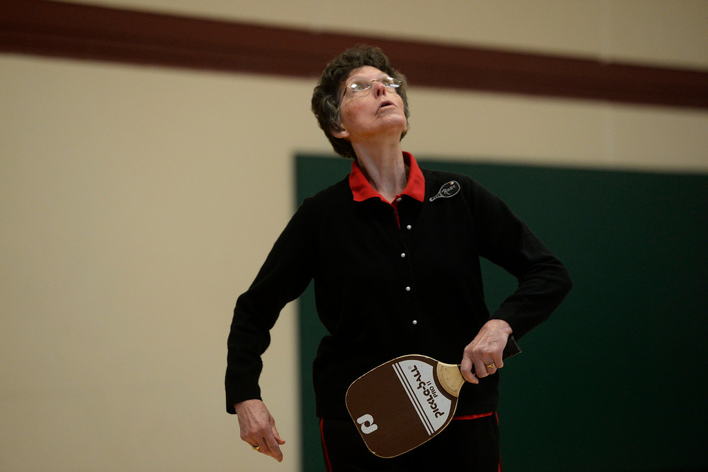 . Pickleball player, Rose Swier, 78, looks for a lob at a Pickleball skills and drills session at the Apex Center Tuesday morning, February 11, 2014. Pickleball combines elements of tennis, ping-pong and badminton that is played on a court, half the size of a tennis court. (Photo By Andy Cross / The Denver Post)