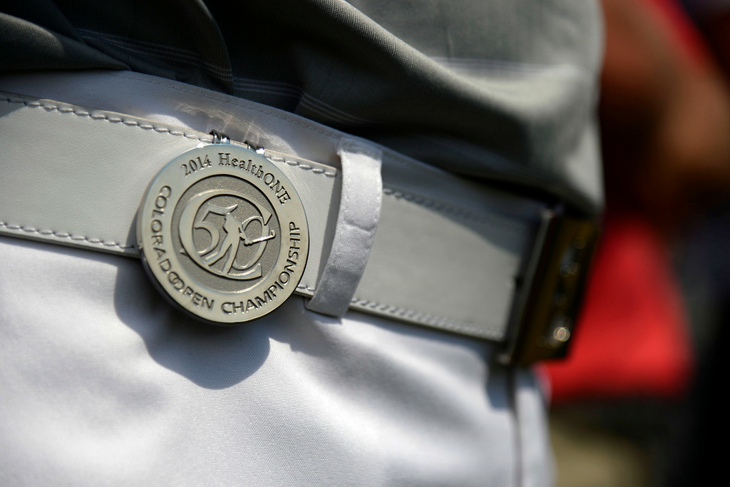 . Champion Ian Davis wears a commemorative coin on his belt during the Colorado Open.  Photo by AAron Ontiveroz/The Denver Post)