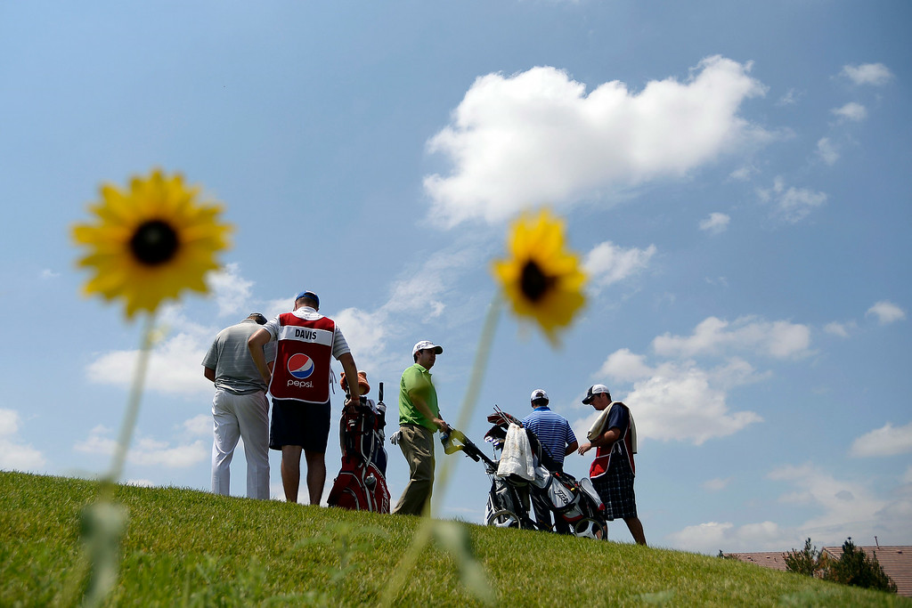 . The lead group prepares to tee off on 14 during the Colorado Open. (Photo by AAron Ontiveroz/The Denver Post)
