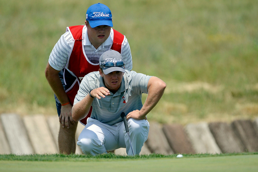 . Champion Ian Davis lines up a putt with his caddy, Ben Nemececk during the Colorado Open.  (Photo by AAron Ontiveroz/The Denver Post)