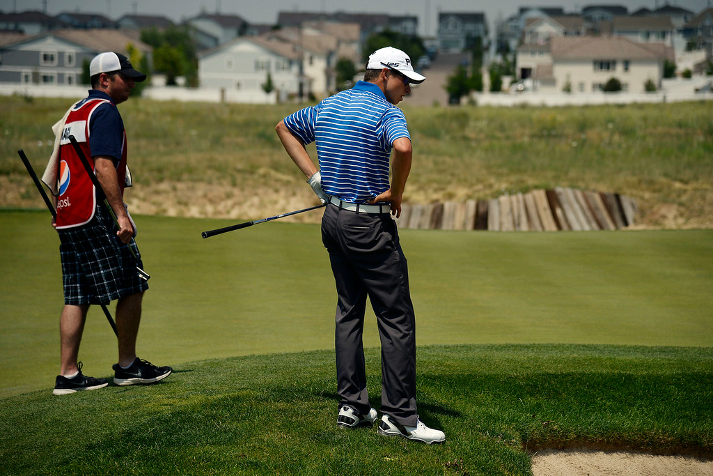 . Brandon Hagy reacts after hitting out of a bunker and into the rough on the back nine during the Colorado Open.   (Photo by AAron Ontiveroz/The Denver Post)