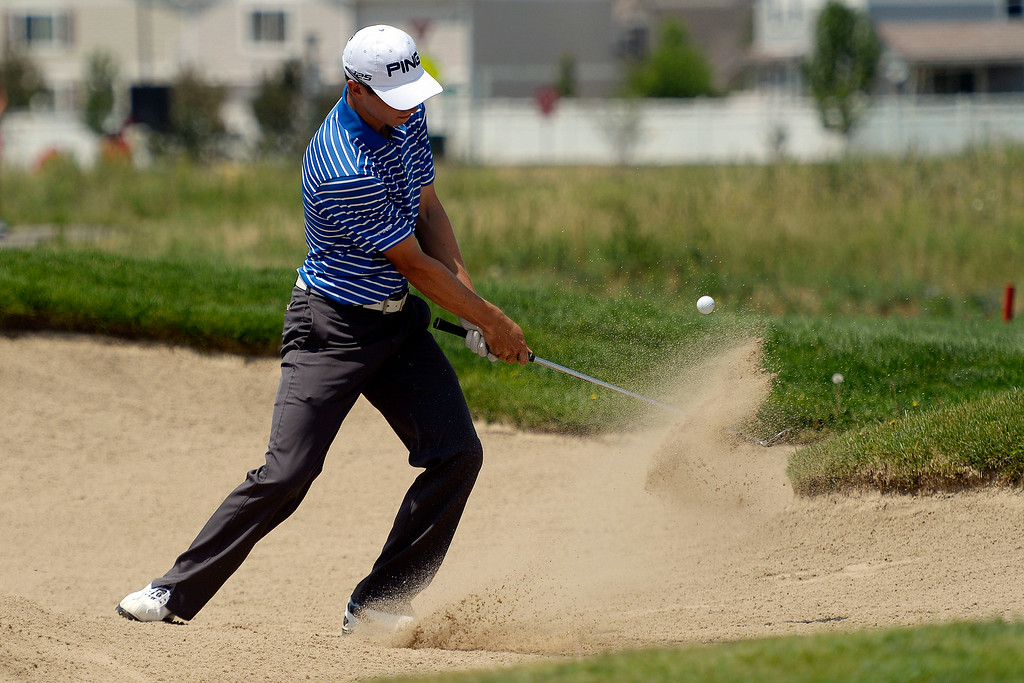 . Brandon Hagy hits out of a bunker on the back nine during the Colorado Open.   (Photo by AAron Ontiveroz/The Denver Post)