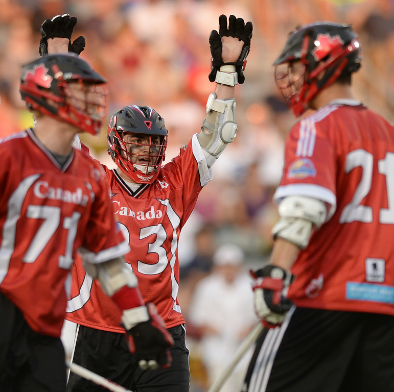 . COMMERCE CITY, CO - JULY 19: Canada attack Adam Jones (23) celebrated a goal in the first half. The United States faced Canada in the FIL World Lacrosse Championship game Saturday night, July 19, 2014.  Photo by Karl Gehring/The Denver Post