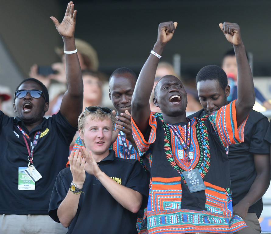 . COMMERCE CITY, CO - JULY 19: Ugandan players cheered during closing ceremonies Saturday night. This was the first year that at team from Africa participated in the World Lacrosse Championships. The United States faced Canada in the FIL World Lacrosse Championship game Saturday night, July 19, 2014.  Photo by Karl Gehring/The Denver Post