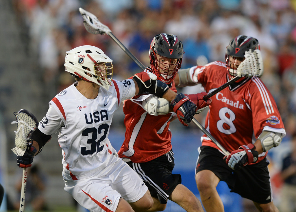 . COMMERCE CITY, CO - JULY 19:  US attack Rob Parnell (32) made a run with the ball in the second half. Canada defeated the United States 8-5 in the FIL World Lacrosse Championship game Saturday night, July 19, 2014.  Photo by Karl Gehring/The Denver Post