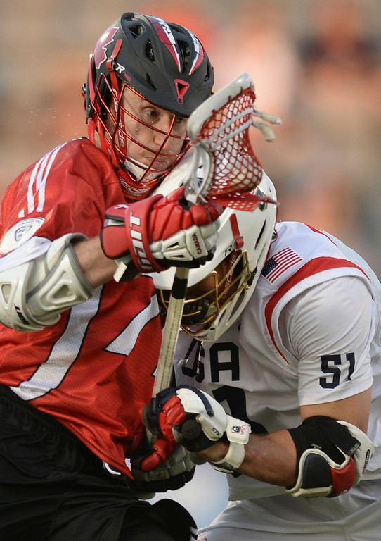 . COMMERCE CITY, CO - JULY 19: Canada attack Curtis Dickson (71) collided with US defenseman Tucker Durkin (51) in the first half. The United States faced Canada in the FIL World Lacrosse Championship game Saturday night, July 19, 2014.  Photo by Karl Gehring/The Denver Post