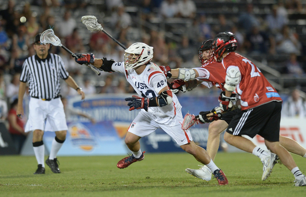 . COMMERCE CITY, CO - JULY 19:  US midfielder Max Seibald (42) lunged for a loose ball in the second half. Canada defeated the United States 8-5 in the FIL World Lacrosse Championship game Saturday night, July 19, 2014.  Photo by Karl Gehring/The Denver Post