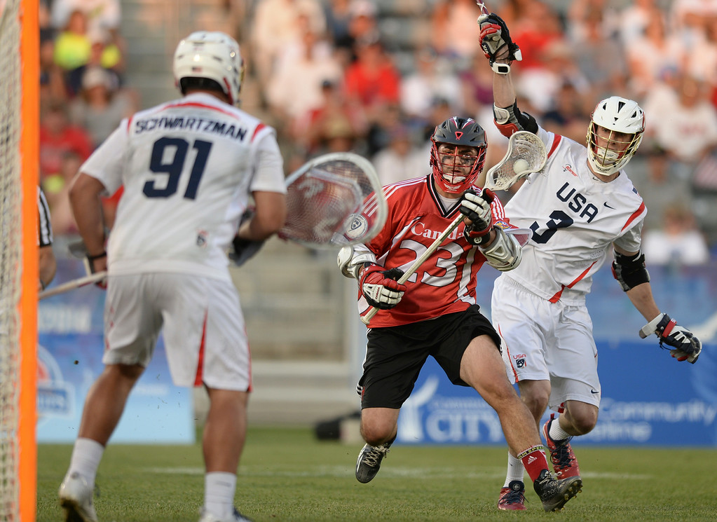 . COMMERCE CITY, CO - JULY 19: Canada attack Adam Jones (23) made a run at the US net in the first half. The United States faced Canada in the FIL World Lacrosse Championship game Saturday night, July 19, 2014.  Photo by Karl Gehring/The Denver Post