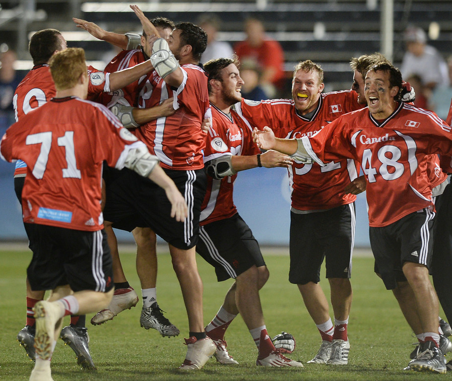 . COMMERCE CITY, CO - JULY 19:  Canadian players stormed the field after the win. Canada defeated the United States 8-5 in the FIL World Lacrosse Championship game Saturday night, July 19, 2014.  Photo by Karl Gehring/The Denver Post